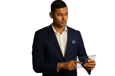 Front view close up of a young mixed race businessman wearing a black jacket and white shirt using a transparent handheld wireless device