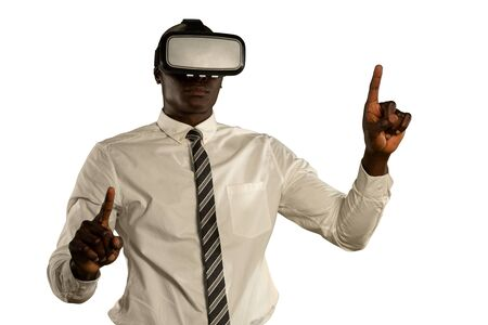 Front view close up of a young African American businessman wearing a shirt and tie and a VR headset, with hands held out in front of him and fingers extended, pointing or touching