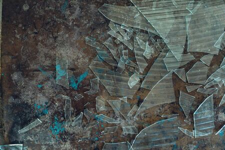 Close up detail of the interior of an abandoned warehouse space showing broken glass