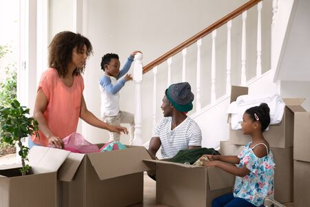 Front view of an African American couple with her son and daughter at home Stock Photo