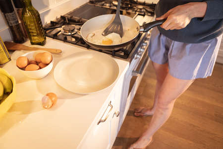 Low section Caucasian woman spending time at home, cooking in the kitchen. Lifestyle at home isolating, social distancing in quarantine lockdown during coronavirus covid 19 pandemic.