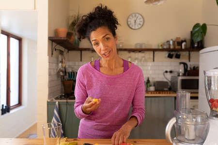 Portrait of caucasian woman cooking in kitchen at home. Staying at home in self isolation during quarantine lockdown. Standard-Bild