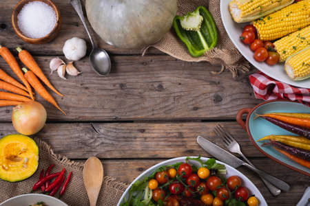Composition of autumn halloween food harvest with copy space on wooden background. autumn, halloween tradition, food, cooking and celebration concept.