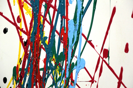 medium shot: Gouache smeared on a white wall. Various colors and shapes. Medium Shot.