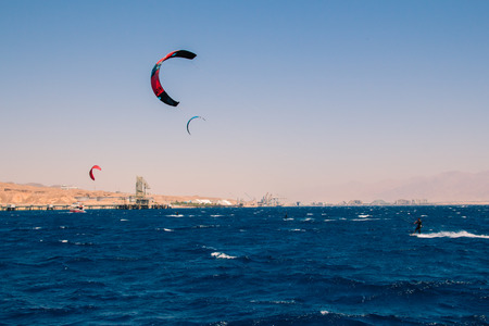 windsurfers: Windsurfers sailing in the Red Sea. Near the beach of Eilat Israel. Stock Photo