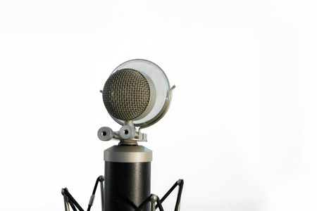 condenser: Close up of a vocal condenser microphone with wind screen isolated on white background.