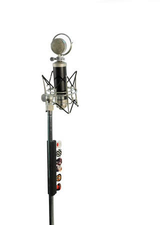 vocal: Long shot of a vocal condenser microphone with wind screen isolated on white background. Five illustrated plectrums connected to on the stand.