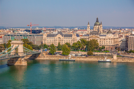 saint stephen cathedral: Budapest cityscape, including chain bridge, St Stephens Basilica, Ministry of the Interior, the Four Seasons Hotel and the Danube river in Budapest, Hungary