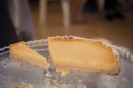 torte: Slice lemon torte on a glass plate