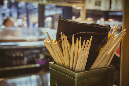 china cuisine: Many chopsticks inside a box in restaurant. Selective Focus.