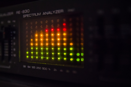 decibels: Graphic equalizer bars on an audio system - Close Up Selective Focus