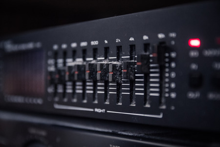 graphic equalizer: Graphic equalizer controls on an audio system - Close Up Selective Focus