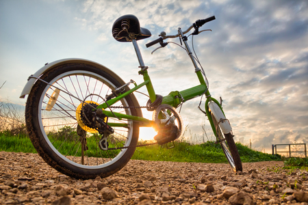 dirt road recreation: Bicycles parked on a dirt road during sunset Stock Photo