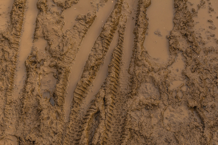 scrambling: Texture of wet brown mud with bicycle tyre tracks