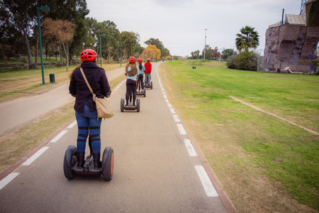 segway: Group of people traveling on Segway in the park Stock Photo