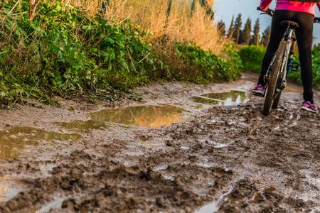 water sport: Bicycle ride through muddy dirt road