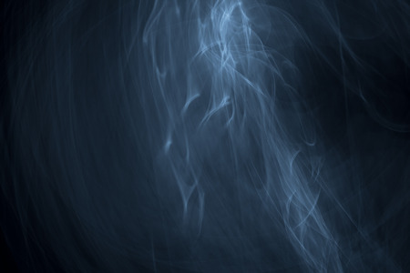 strobe light: Light painted glowing abstract light blue and white curved lines on a black background