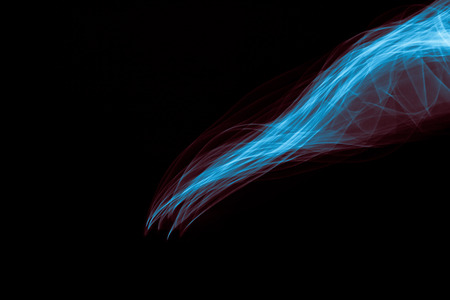 strobe light: Light painted glowing abstract blue and red curved lines on a black background