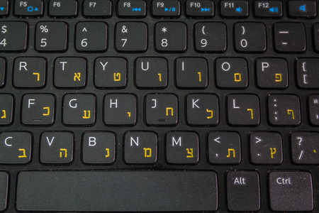english letters: Keyboard with letters in Hebrew and English - Laptop keyboard - Top View - Close up