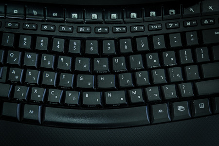 hebrew alphabet: Keyboard with letters in Hebrew and English - Wireless keyboard - Top View -  Dark atmosphere