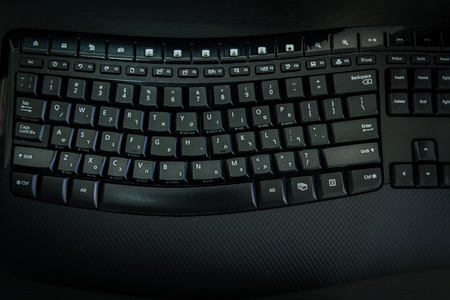 hebrew letters: Keyboard with letters in Hebrew and English - Wireless keyboard - Top View -  Dark atmosphere