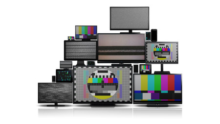 Many different types of screens. TVs, computer monitors, smartphones and tablets. They laid on each other in a pile isolated on a white background. They are all with no signal.