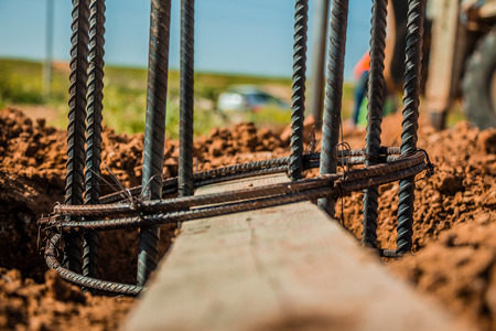 strong base: Steel rod used for poles construction with reinforce concrete in a hole in the ground at construction site. Stock Photo