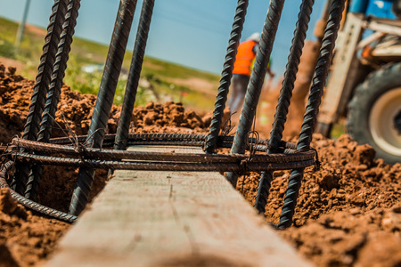 reinforce: Steel rod used for poles construction with reinforce concrete in a hole in the ground at construction site. Stock Photo