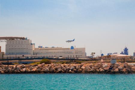 light aircraft: Light aircraft landing above the sea. Mediterranean coast, Tel Aviv, Israel.