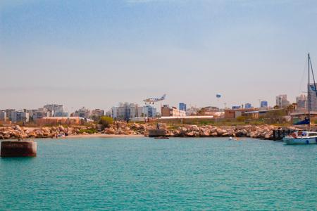 aircraft landing: Light aircraft landing above the sea. Mediterranean coast, Tel Aviv, Israel.