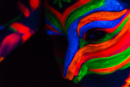 futuristic girl: Woman with make up art of glowing UV fluorescent powder. Stock Photo