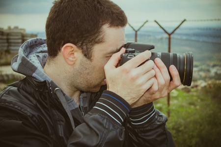 outside shooting: Photographer shooting outside with digital camera.