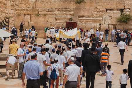 hassid: Jerusalem, Israel - May 9, 2016: Jewish worshipers gather for a Bar Mitzvah ritual at the Western wall in Jerusalem. Editorial