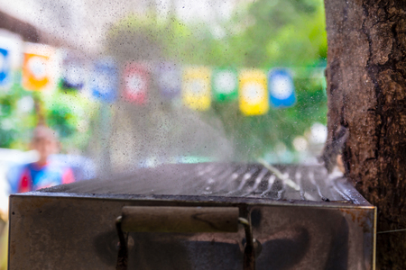 hi speed: Highspeed photo of water bursting out from balloon that placed on a hot grill . An experiment that tests what would be the reaction of the balloon with the cold water to the heat comes off the grill. Stock Photo