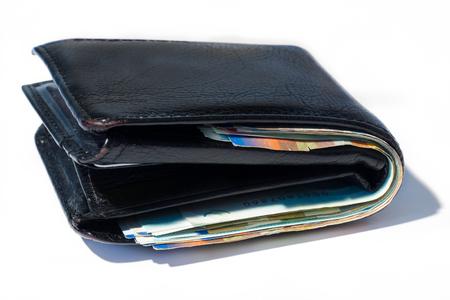 sheqel: Stack of various of israeli shekel money bills in close black leather wallet.