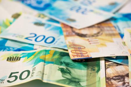 israeli: Stack of various of israeli shekel money bills.