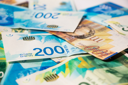 Stack of various of israeli shekel money bills.