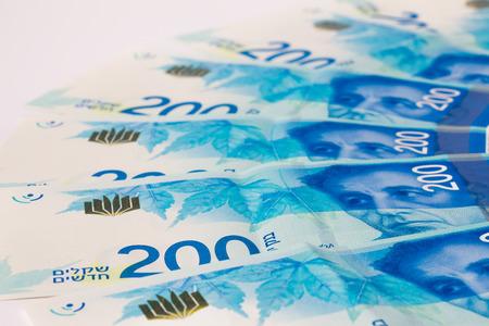 sheqel: Stack of Israeli money bills of 200 shekel.