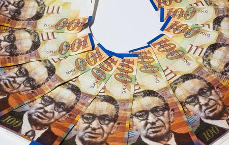 sheqel: Stack of Israeli money bills of 100 shekel - top view. Stock Photo