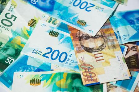 Stack of various of israeli shekel money bills - Top View.