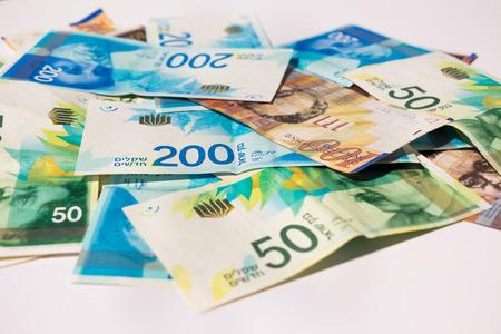 sheqel: Stack of various of israeli shekel money bills.