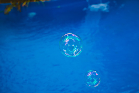 Soap bubbles fly in the swimming pool.