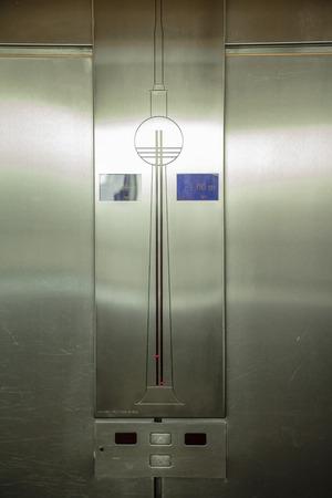 tilting: Elevator panel inside the TV Tower of Berlin