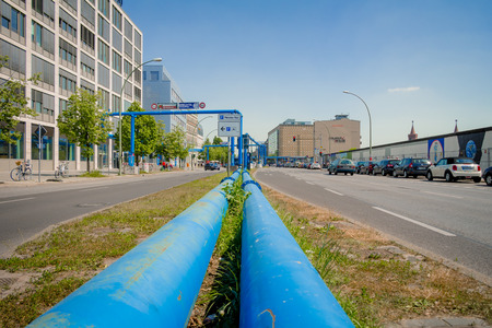 groundwater: Berlin, Germany - May 19, 2017: Blue pipes at the street of Berlin city. The pipes are used to pump water away from construction sites due to the citys high groundwater level.