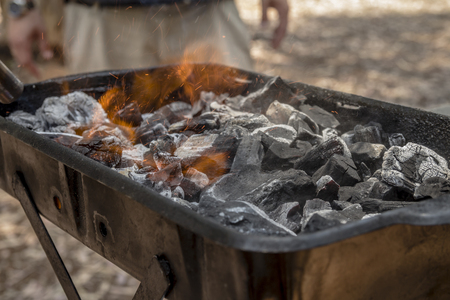 holzbriketts: Coals are burned in a BBQ grill Lizenzfreie Bilder