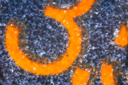 embedded: Embedded digit 3 on sim card under the microscope. Closeup macro photography. Stock Photo