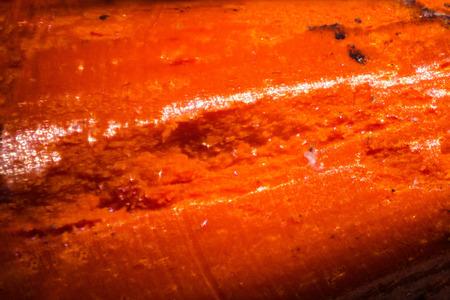 Orange pencil tip under the microscope. Closeup macro photography.