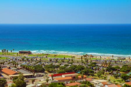 Aerial view of Tel Aviv promenade. Recognized places such as the Etzel Museum, Tel Aviv beach and Neve Tzedek neighborhood. Tilt shift. Stock Photo