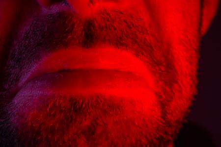Macro closeup on man lips with sad facial expression. Portrait of melancholy face. Stock Photo