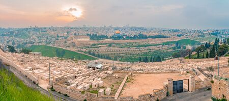 Panoramic view of Jerusalem old city and the Temple Mount during a dramatic colorful sunset. A view of the Tomb of the Prophets, Dome of the Rock and Al Aqsa Mosque from the Mount of Olives in Jerusalem, Israel.